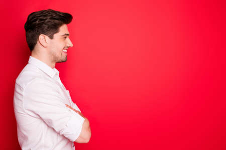 Profile side view portrait of his he nice attractive cheerful cheery glad content guy top management ceo boss chief director copy empty blank place space isolated on bright vivid shine red background Stock fotó