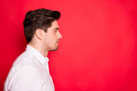Close-up profile side view portrait of his he nice attractive calm peaceful guy student copy empty blank space place isolated over bright vivid shine red background