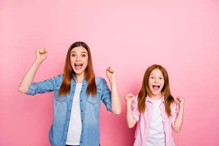 Pretty foxy little lady and her mom celebrating lottery win wear casual jeans clothes isolated pink background