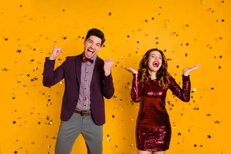 Portrait of wild person buddies having fun wear stylish outfit scream shout wavy curly hairstyle isolated over yellow background
