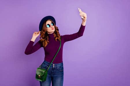 Portrait of lovely youth make photo wear trendy stylish denim clothing eyewear eyeglasses isolated over purple violet background Banco de Imagens