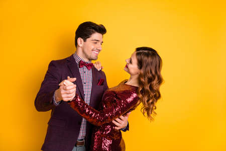 Portrait of his he her she nice-looking attractive lovely well-dressed pretty gorgeous charming fascinating cheerful cheery people having fun isolated over bright vivid shine yellow background