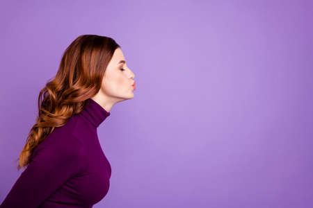 Profile side photo of cute lady youth close eyes send air kisses isolated over purple violet background Stock Photo