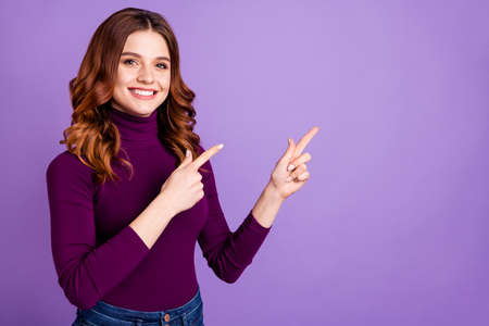 Portrait of her she nice attractive confident cheerful cheery positive wavy-haired girl pointing two forefingers ad advert copy space isolated over pastel purple violet lilac background