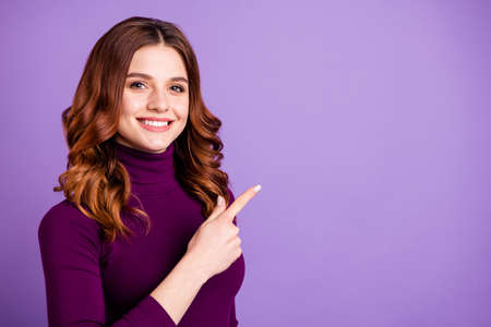 Close-up portrait of her she nice attractive lovely confident cheerful cheery positive wavy-haired girl pointing ad promotion copy space isolated over pastel purple violet lilac background Stok Fotoğraf - 129251279