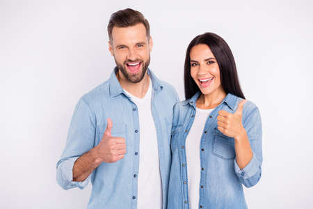Portrait of his he her she nice-looking attractive lovely charming cheerful cheery glad persons showing thumbup ad advert agree isolated over light white pastel background