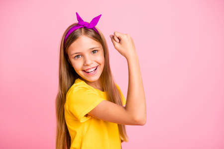Close-up portrait of her she nice attractive lovely winsome cheerful cheery confident pre-teen girl wearing yellow t-shirt celebrating attainment isolated over pink pastel background