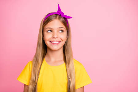 Photo of kind cute glad cheerful girl looking away watching something while isolated with pink background Stock fotó