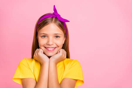 Close-up portrait of her she nice-looking shine attractive lovely winsome cheerful cheery peaceful pre-teen girl wearing yellow t-shirt holiday springtime isolated over pink pastel background Stok Fotoğraf