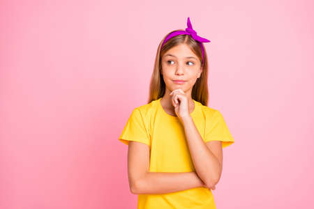 Close-up portrait of her she nice-looking attractive pretty shine creative pre-teen girl wearing yellow tshirt creating solution isolated over pink pastel background 写真素材