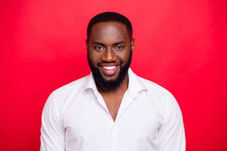Photo of dark skin macho guy wear white shirt isolated bright red background