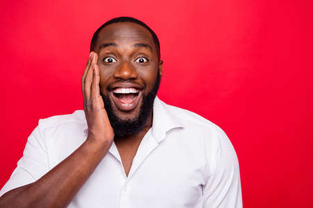 Photo of dark skin guy astonished by achievement wear white shirt isolated bright red background