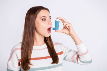 Breathing in bronchospasm attack spray lady wear striped pullover isolated white background
