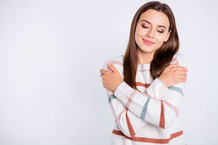 Photo of overjoyed lady crossing hands touching nice striped pullover isolated white background