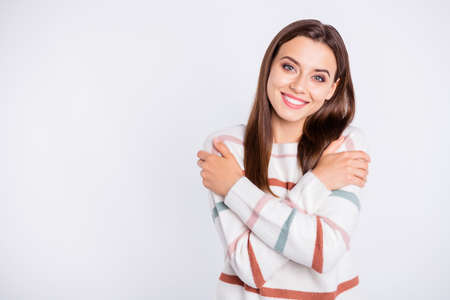 Photo of amazing lady crossing hands touching nice striped pullover isolated white background Stock Photo