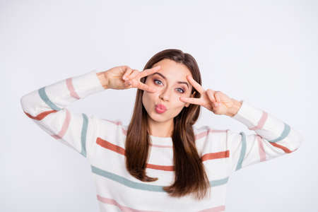 Amazing lady showing v-sign symbol near eyes sending air kiss wear striped pullover isolated white background