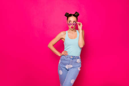 Photo of pretty lady look empty space send air kiss wear sun specs casual outfit isolated pink background