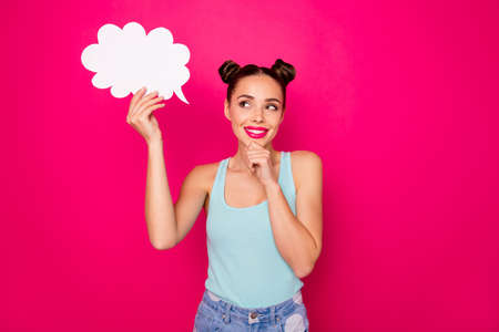 Portrait of charming person holding paper card bubble having thoughts touching her chin isolated over fuchsia background