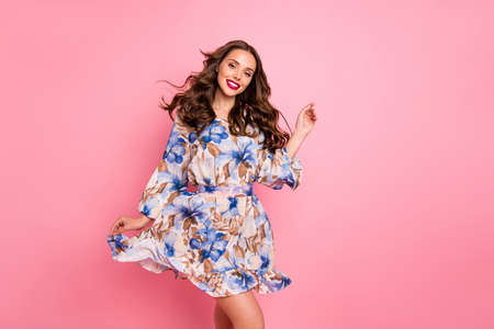 Nice lady overjoyed by warm spring breeze going romantic date wear cute dress isolated pink background Banco de Imagens