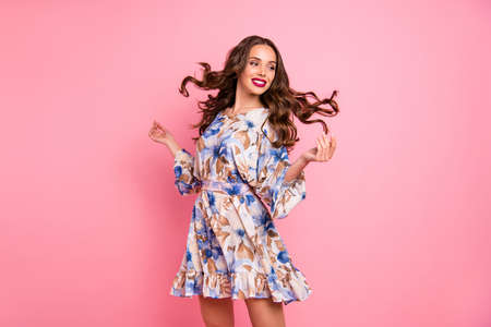 Portrait of her she nice-looking attractive lovely fascinating feminine slim fit cheerful cheery glad wavy-haired girl spinning wind blows hair holiday isolated over pink background Stockfoto