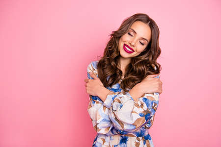 Portrait of her she nice-looking attractive lovely sweet gentle pretty winsome lovable cheerful cheery wavy-haired lady hugging herself closed eyes isolated over pink pastel background Stock Photo