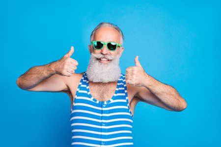 Close-up portrait of his he nice attractive content cheerful cheery glad gray-haired man showing two double thumbup great resort spa ad isolated over bright vivid shine turquoise blue background Stok Fotoğraf
