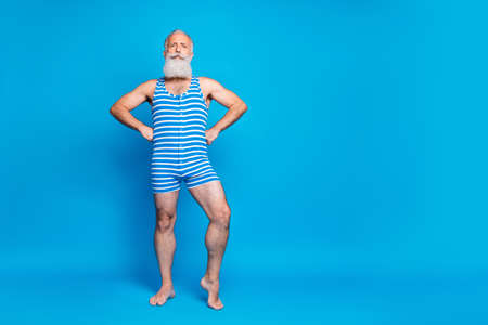Full length body size view of his he nice attractive trendy stylish content strong gray-haired man posing spending weekend isolated over bright vivid shine turquoise blue green background Banque d'images - 129430953