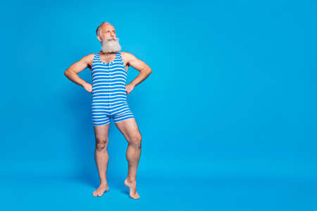 Full length body size view of his he nice attractive trendy stylish content cool strong proud gray-haired man isolated over bright vivid shine turquoise blue green background Banque d'images - 129430994