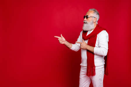 Portrait of his he nice attractive handsome confident classy gray-haired man demonstrating copy space ad advert solution decision black Friday isolated over bright vivid shine red background 스톡 콘텐츠