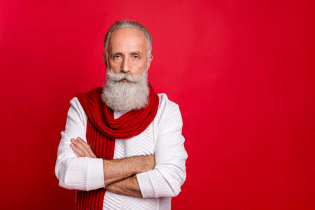 Close-up portrait of his he nice attractive groomed calm content gray-haired man folded arms Santa Claus work look apparel isolated over bright vivid shine red background