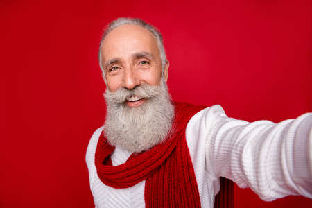 Self-portrait of his he nice attractive well-groomed confident content cheerful gray-haired man grandpa isolated over bright vivid shine red background