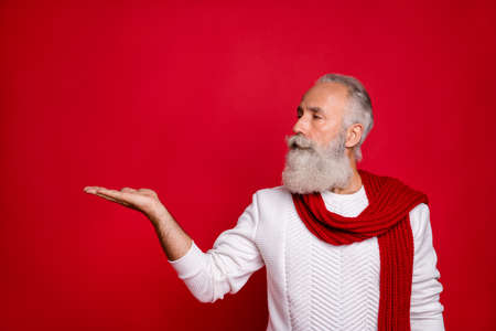 Profile side photo of classy pensioner with gray hair look at copyspace promo wearing white pullover isolated over red background Stock Photo