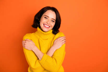 Photo of attractive beautiful nice cute charming trendy gorgeous casual girlfriend warmened with sweater feeling perfect while isolated with orange background Stock Photo