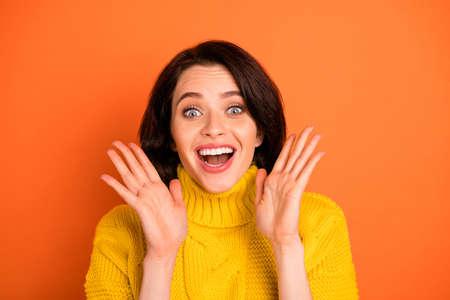 Photo of fascinating shocked impressed funny girl seeing something unbelievable while isolated with orange background