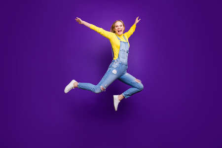 Full size photo of lovely youth raising her hands screaming isolated over purple violet background
