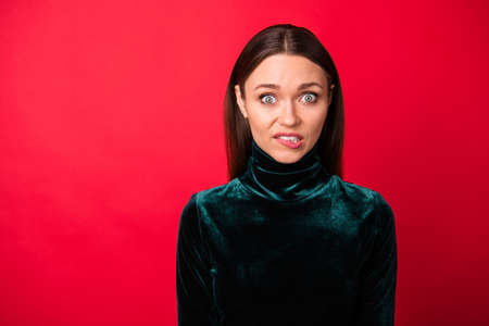 Close up photo of frustrated lady bite lips have thoughts unbelievable unexpected information look stare isolated over red background