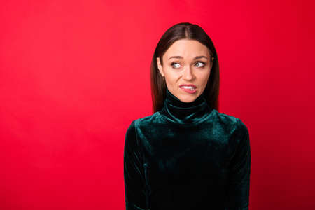 Portrait of depressed disappointed lady look have thoughts unbelievable unexpected horrible information isolated over red background