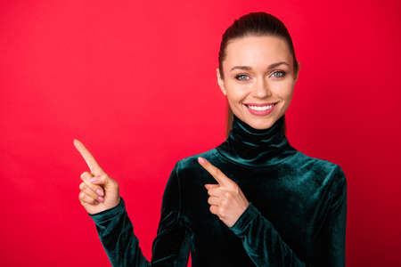 Close-up portrait of her she nice-looking attractive winsome pretty lovely lovable charming cute cheerful cheery straight-haired lady showing copy space isolated over bright vivid shine red background Stock Photo