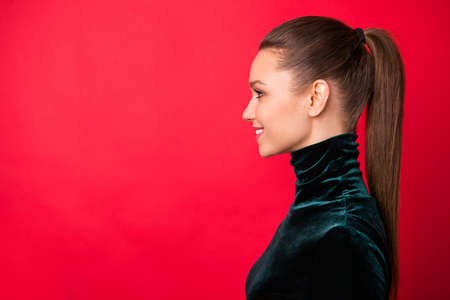 Close-up profile side view portrait of her she nice attractive winsome lovable charming cute cheerful cheery straight-haired lady copy space isolated over bright vivid shine red background