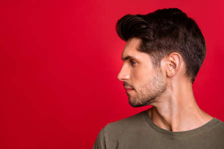 Photo of macho guy turn head side showing new hairstyle wear grey t-shirt isolated on red background 写真素材