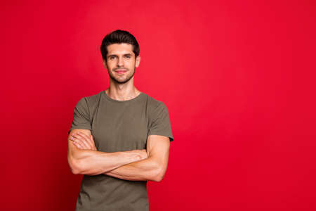Photo of reliable worker hold hands crossed wear casual grey t-shirt isolated on red background