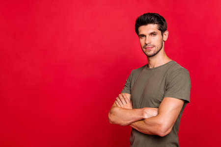 Profile photo of reliable worker hold hands crossed wear casual grey t-shirt isolated on red background 写真素材