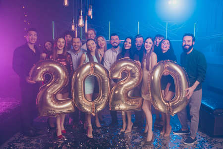 Full length body size view of nice attractive gorgeous glamorous cheerful positive girls and guys having fun chill out corporate occasion rest relax celebratory 2020 fairy in luxury place nightclub