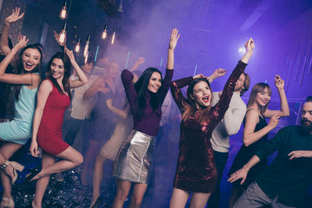 Portrait of attractive pretty sweet high-school person raising hands arms people occasion excited laugh laughter formalwear formal wear dress indoors dance floor Stock Photo