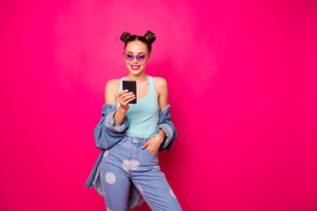 Pretty lady hold telephone hands reading love letter wear sun specs casual outfit isolated bright pink background