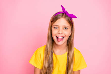 Close-up portrait of her she nice-looking attractive perfect winsome shine cheerful cheery hilarious humorous pre-teen girl wearing yellow t-shirt fooling isolated over pink pastel background