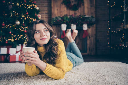 Photo of charming beautiful girlfriend staring away thinking about celebrating new year while wearing jeans denim yellow pullover Imagens