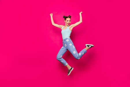Full size photo of pretty lady raising hands fists wearing blue singlet isolated over fuchsia background Stock Photo - 129622280