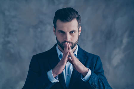 Close up photo of pensive man touching fingers having thoughts wearing blazer jacket isolated over grey background Фото со стока