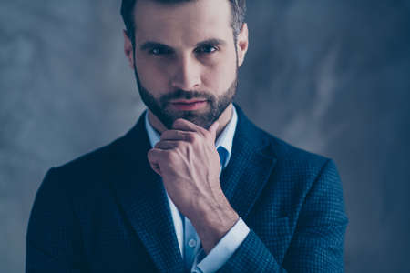 Cropped photo of pensive elegant man touching his chin thinking wearing modern jacket blazer isolated over gray background Reklamní fotografie